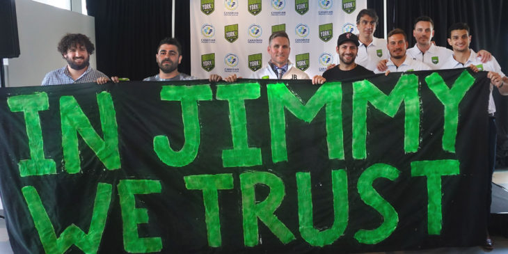 Lucas Piatti (second from left) joins fellow Generation IX supporters after Jim Brennan was revealed as coach of York 9 FC. (Armen Bedakian)